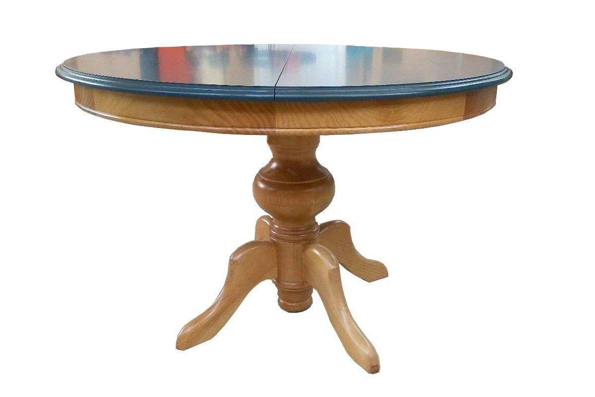 Mesa redonda de madera base piña gruesa.