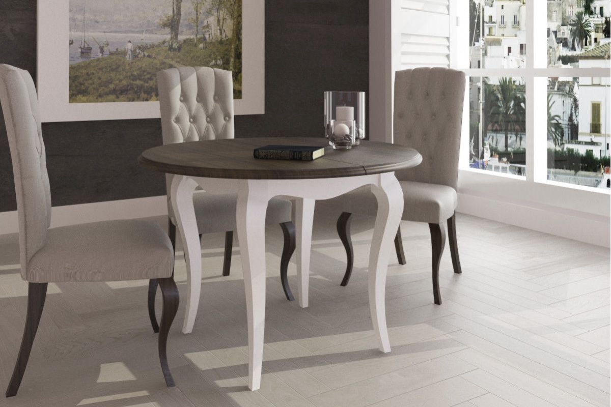 Mesa redonda isabelina de madera fija y extensible.